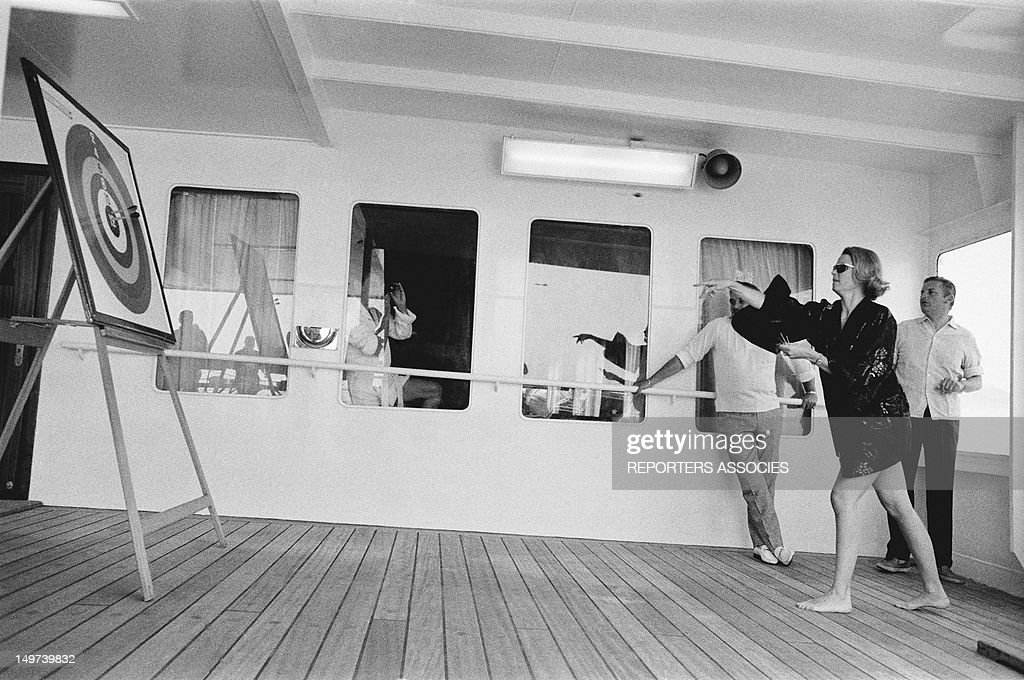 Princess Grace Of Monaco playing darts on a boat, June 1966, Monaco.