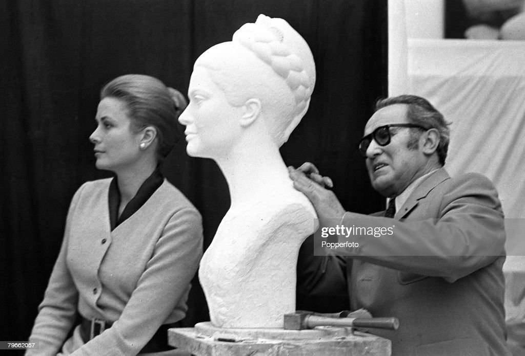 Princess Grace of Monaco poses for French sculptor Lucien Gibert in his studio as he completes a bust of her, Paris, France, 10th November 1970.