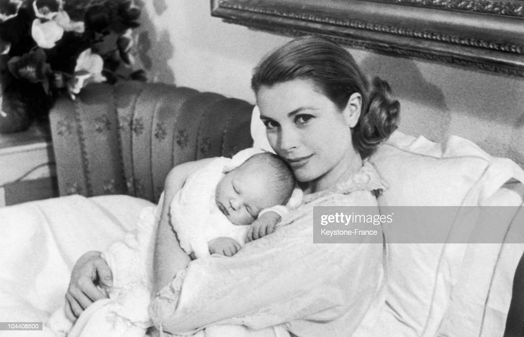 Princess Grace of Monaco tenderly holding her first child, Prince Albert, born on March 14, 1958, in Monaco.