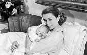 Princess Grace of Monaco tenderly holding her first child Prince Albert born on March 14 in Monaco