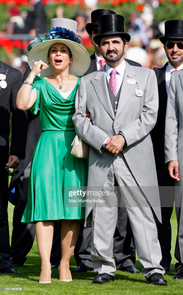 HRH <a gi-track='captionPersonalityLinkClicked' href=/galleries/search?phrase=Princess+Haya&family=editorial&specificpeople=658825 ng-click='$event.stopPropagation()'>Princess Haya</a> Bint Al Hussein and HH Sheikh <a gi-track='captionPersonalityLinkClicked' href=/galleries/search?phrase=Mohammed+Bin+Rashid+Al+Maktoum&family=editorial&specificpeople=658741 ng-click='$event.stopPropagation()'>Mohammed Bin Rashid Al Maktoum</a> watch the racing as they attend Royal Ascot Ladies Day at Ascot Racecourse on June 17, 2010 in Ascot, England.