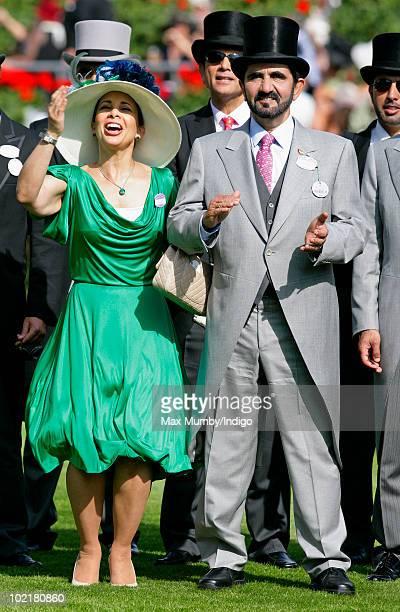HRH Princess Haya Bint Al Hussein and HH Sheikh Mohammed Bin Rashid Al Maktoum watch the racing as they attend Royal Ascot Ladies Day at Ascot...