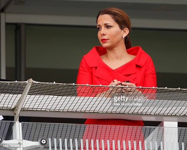 Princess Haya Bint Al Hussein holds some prayer beads whilst watching the racing as she attends Derby Day of the Investec Derby Festival at Epsom...