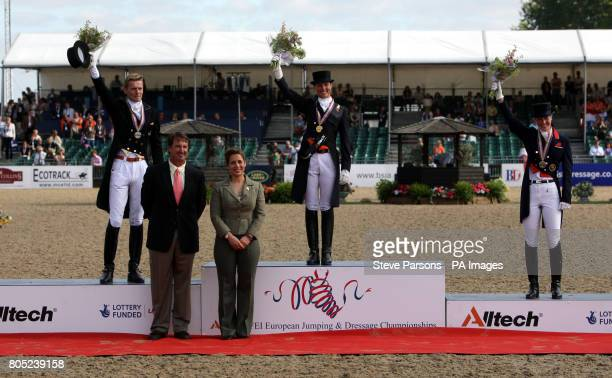 Princess Haya of Jordan stands with medal winners Great Britain's Laura Bechtolsheimer with her bronze medal Silver medalist Netherlands Edward Gal...