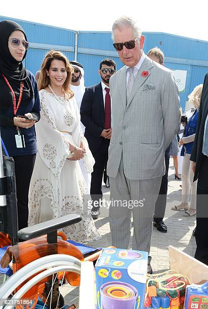 Princess Haya of Jordan stands with Prince Charles Prince of Wales during a tour of the International Humanitarian City to see the innovation and...