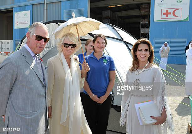 Princess Haya of Jordan talks with the Prince Charles Prince of Wales and Camilla Duchess of Cornwall holding a parasol as they tour the...