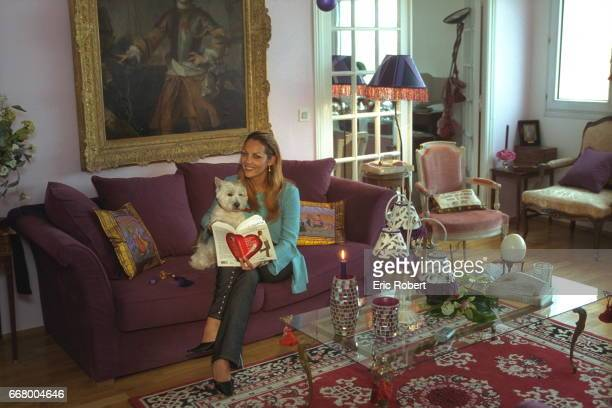 Princess Hermine de Clermont Tonnerre at home with her inseparable dog skimming through her novel