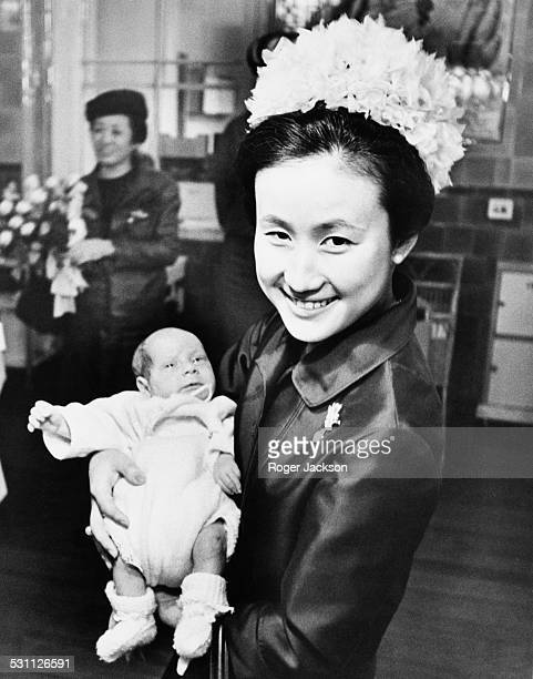 Princess Hitachi the wife of Prince Hitachi holding fiveweekold Simon Pink during a visit to St Thomas' Hospital London 28th October 1965 She and her...