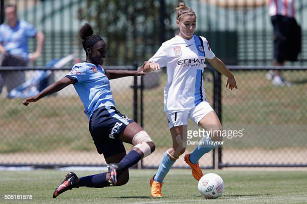 Princess Ibini of Sydney FC and Steph Catley of Melbourne City compete for the ball during the round 14 WLeague match between Melbourne City FC and...