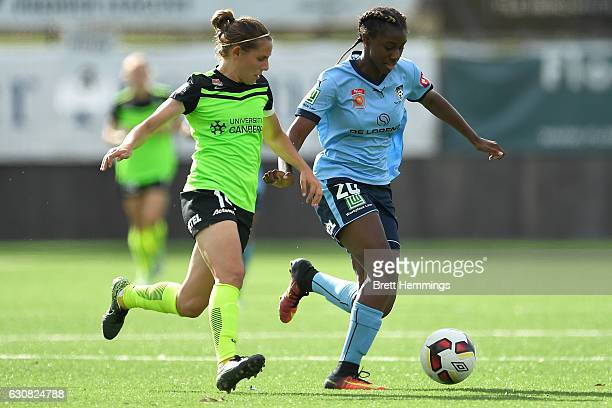 Princess IbiniIsei of Sydney and Ashleigh Sykes of Canberra contest the ball during the round 10 WLeague match between Sydney and Canberra at Lambert...