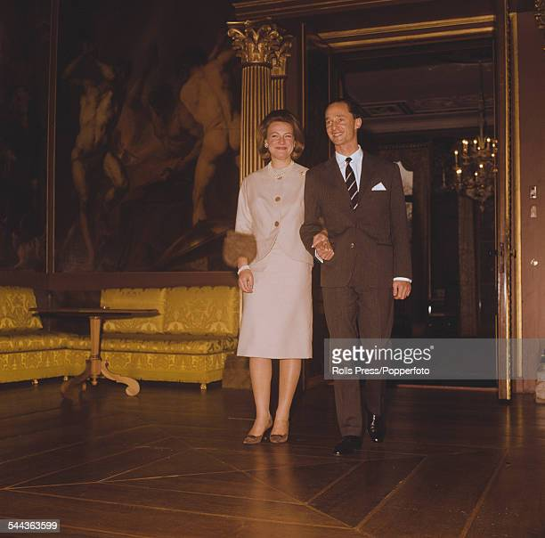 Princess Irene of the Netherlands walks hand in hand with Carlos Hugo Duke of Parma through the Royal Palace in Madrid Spain after the announcement...