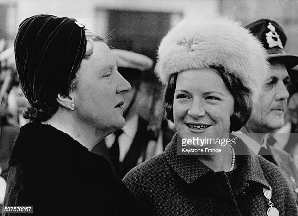 Princess Irene very graceful with her new modern hairstyle and wearing a white fur hat is with her mother Queen Juliana on October 31 1960 in...