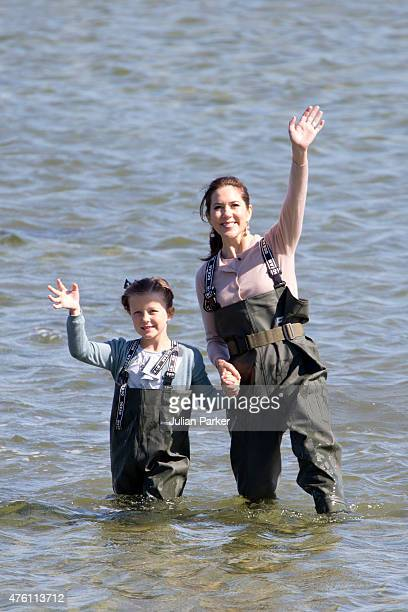 Princess Isabella of Denmark accompanied by her mother Crown Princess Mary of Denmark visits a nature school and view fish and shrimps in the estuary...