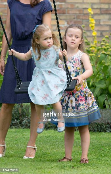 Princess Isabella of Denmark pushes her sister a Princess josephine of Denmark during the annual Summer photocall for the Royal Danish family at...
