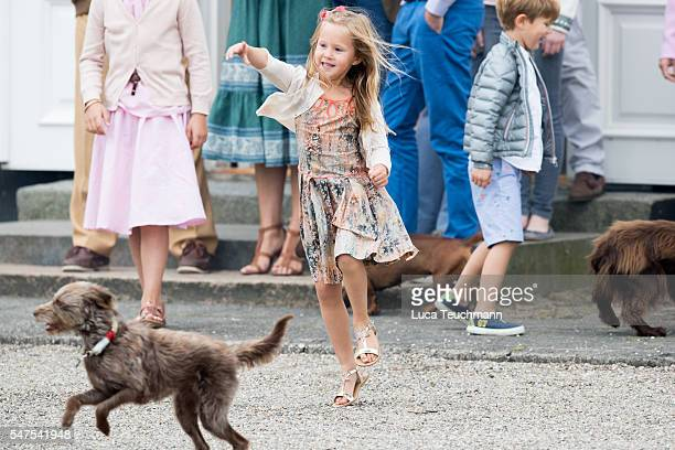 Princess Josephine of Denmark throws a ball during the annual summer photo call for The Danish Royal Family at Grasten Castle on July 25 2015 in...