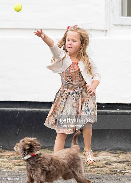 Princess Josephine of Denmark throws a ball for a dog during the annual summer photo call for The Danish Royal Family at Grasten Castle on July 25...
