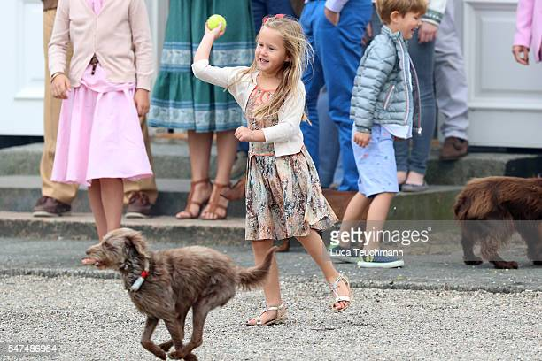 Princess Josephine of Denmark throws a ball for a dog the annual summer photo call for The Danish Royal Family at Grasten Castle on July 15 2016 in...
