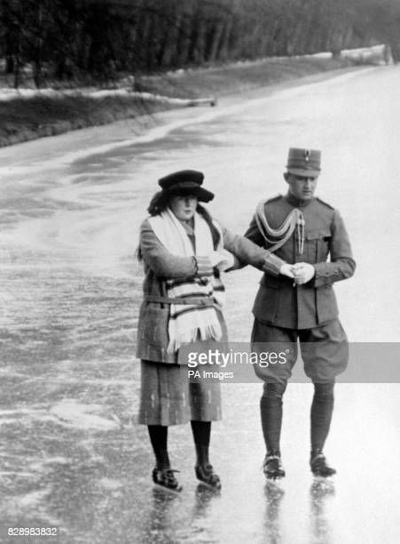 Princess Juliana the daughter of Queen Wilhelmina skating on the ice behind the Royal Palace at the Hague with one of the Queen of Holland's adjutants