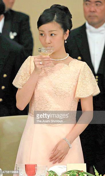 Princess Kako of Akishino drinks a glass of champagne during the state dinner inviting Philippine President Benigno Aquino at the Imperial Palace on...