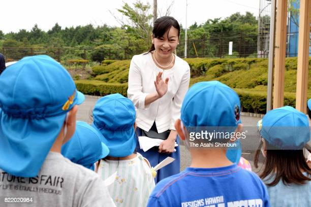Princess Kako of Akishino waves to kindergarten children on arrival at the 51st All Japan High School Equestrian Championships at the Gotemba City...