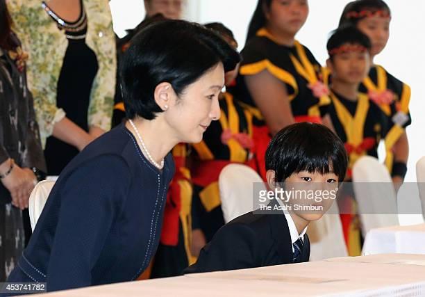 Princess Kiko and Prince Hisahito of Akishino visit the TsushimaMaru exhibition at Keio Plaza Hotel on August 16 2014 in Tokyo Japan