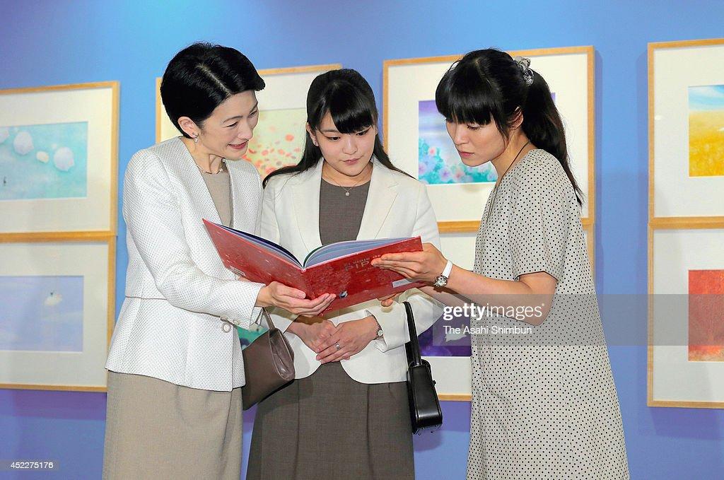 Princess Kiko (L) and Princess Mako (C) of Akishino visit the Bologna Illustrators Exhibition at Itabashi Art Museum on July 16, 2014 in Tokyo, Japan.