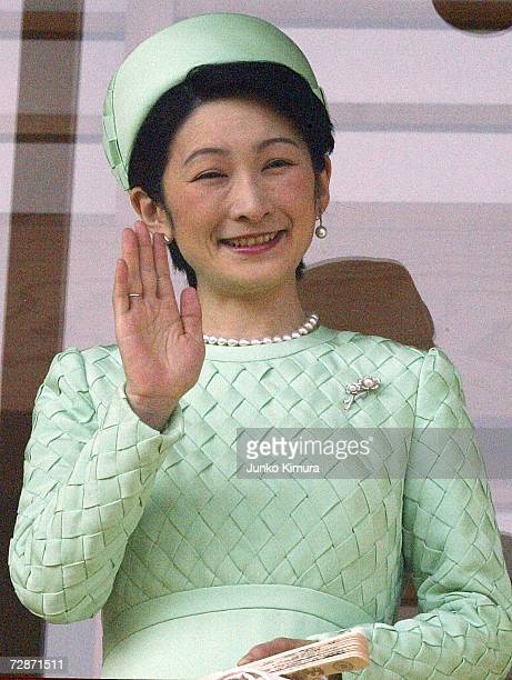 Princess Kiko greets the wellwishers gathered to celebrate Emperor Akihito's birthday at the Imperial Palace December 23 2006 in Tokyo Japan The...