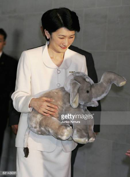 Princess Kiko holding a stuffed toy elephant as she arrives at a cinema at Roppongi Hills to watch the film 'Shining Boy And Little Randy' with...