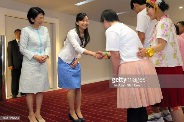 Princess Kiko of Akishino and her second daughter Kako talk with participants after the 'Doremifa Dance Concert' at Tokyo Metropolitan Gymnasium on...