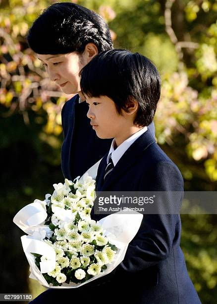 Princess Kiko of Akishino and her son Prince Hisahito offer flowers at the Abomb Hypocenter Memorial at Nagasaki Hypocenter Park on December 6 2016...