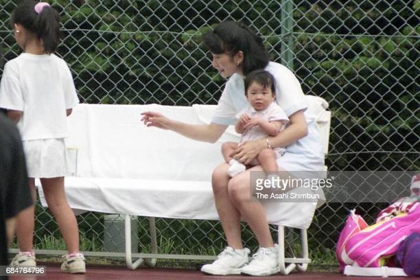 Princess Kiko of Akishino holding her daughter Princess Mako on August 7 1992 in Karuizawa Nagano Japan