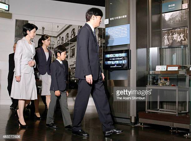 Princess Kiko Princess Kako Prince Hisahito and Prince Akishino watch exhibits during their visit to the National Showa Memorial Museum ahead of the...