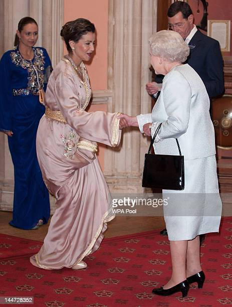 Princess Lalla Meryem of Morocco is greeted by Queen Elizabeth II as he arrives at a lunch for Sovereign Monarch's held in honour of Queen Elizabeth...