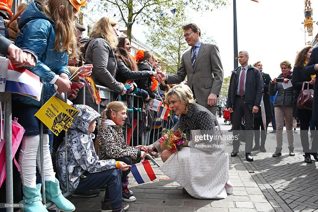 Princess Laurentien of The Netherlands and Prince Constantijn of The Netherlands greet spectators during King's Day (Koningsdag), the celebration of the birthday of the Dutch King, on April 27, 2016 in Zwolle, Netherlands. Parties and concerts are held across the Netherlands as members of the Dutch royal family oversee festivities.