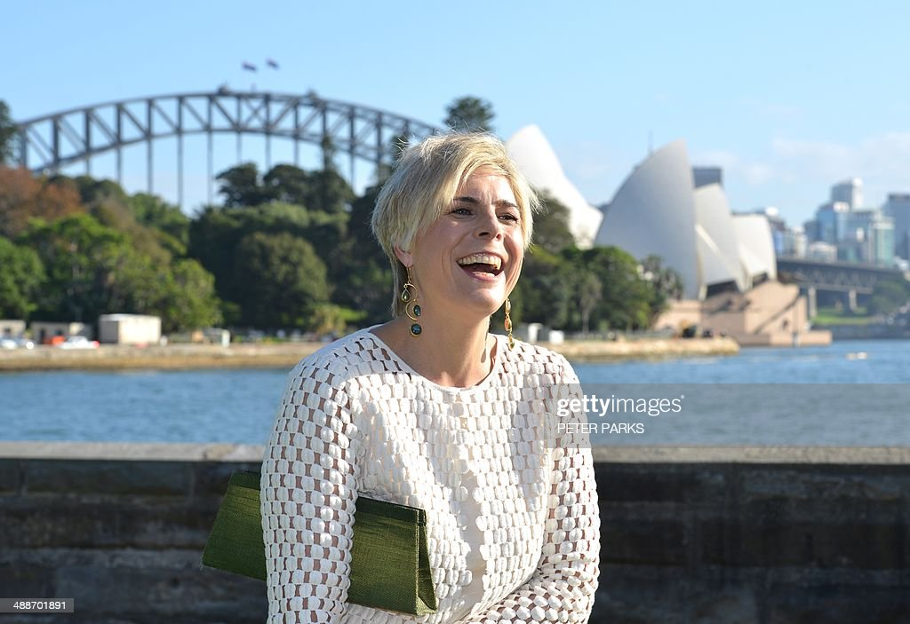 Princess Laurentien of the Netherlands smiles in front of the Sydney Opera House (back R) as she visits the Royal Botanical Gardens in Sydney on May 8, 2014. Laurentien, a UNESCO special envoy, is in Sydney to focus attention on microplastic marine pollution highlighting non-biodegradable microplastic beads found in products such as exfoliants, toothpaste and scrubs which are causing significant damage to oceans and marine life. AFP PHOTO / Peter PARKS
