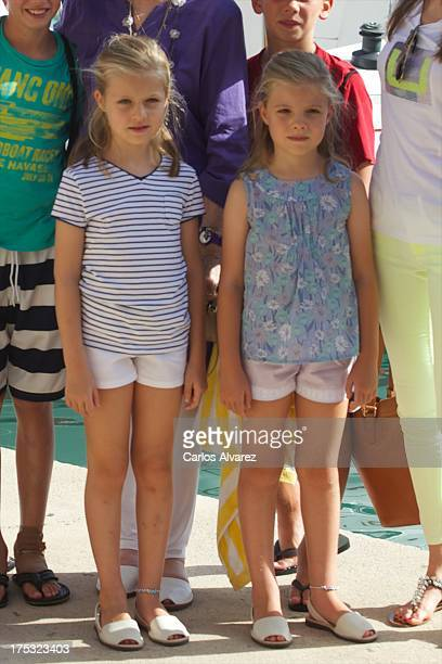 Princess Leonor of Spain and her sister Princess Sofia of Spain pose for the photographers at the Calanova Sailing School on August 02 2013 in Palma...