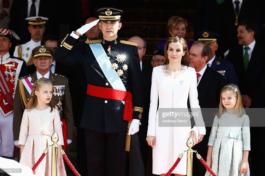 Princess Leonor, Princess of Asturias, King Felipe VI of Spain, Queen Letizia of Spain and Princess Sofia review walk past a guard of Honor at the Congress of Deputies during the King's official coronation ceremony on June 19, 2014 in Madrid, Spain. The coronation of King Felipe VI is held in Madrid. His father, the former King Juan Carlos of Spain abdicated on June 2nd after a 39 year reign. The new King is joined by his wife Queen Letizia of Spain.