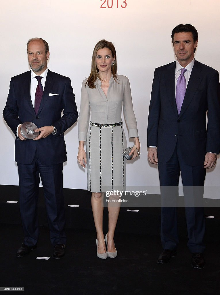 Princess Letizia of Spain (C) and Minister Jose Manuel Soria (R) attend the I National Fashion Awards on June 6, 2014 in Madrid, Spain.