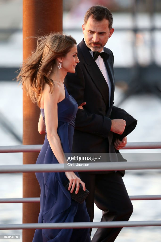 Princess <a gi-track='captionPersonalityLinkClicked' href=/galleries/search?phrase=Letizia+of+Spain&family=editorial&specificpeople=158373 ng-click='$event.stopPropagation()'>Letizia of Spain</a> and Prince Felipe of Spain arrive at the Muziekbouw following the water pageant after the abdication of Queen Beatrix of the Netherlands and the Inauguration of King Willem Alexander of the Netherlands on April 30, 2013 in Amsterdam, Netherlands.