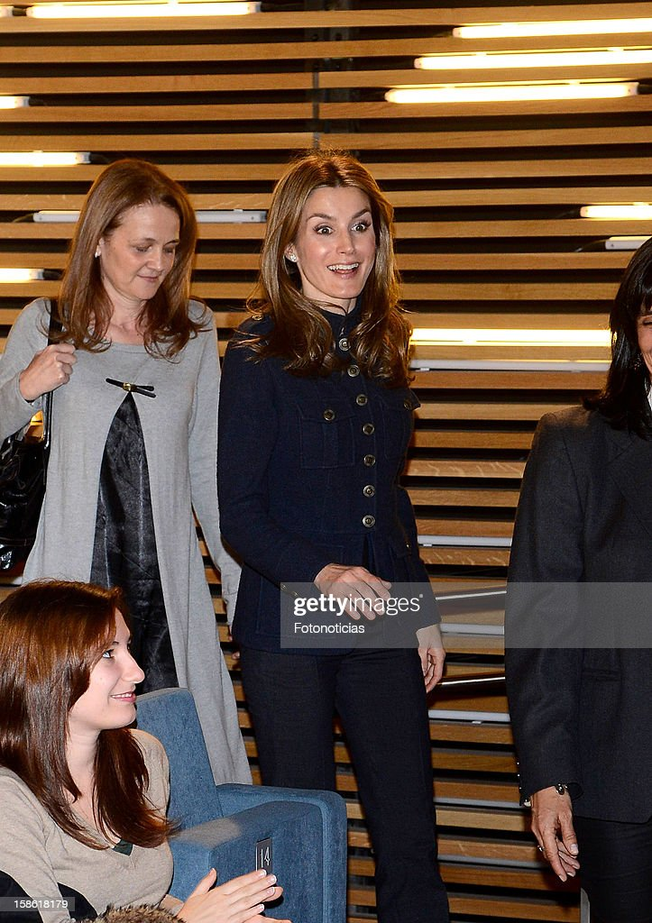 Princess Letizia of Spain (R) attends 'A Que Sabe Este Libro' exhibition at Cuartel Conde Duque on December 21, 2012 in Madrid, Spain.