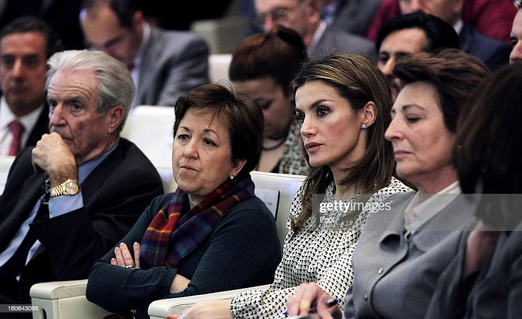 Princess Letizia of Spain, honorary president of the Spanish Association Against Cancer, poses with the secretary general of Health, Pilar Farjas (L), and other participants at the second annual forum 'For a comprehensive approach. Catch it early, you can save your life', at Corporate and Social Headquarters Garrigues on February 04, 2013 in Madrid, Spain.