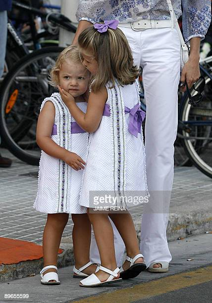 Princess Letizia of Spain walks with her daughters Leonor and Sofia as they leave the Club Nautico de Palma on August 7 2009 The Royal Family spend...