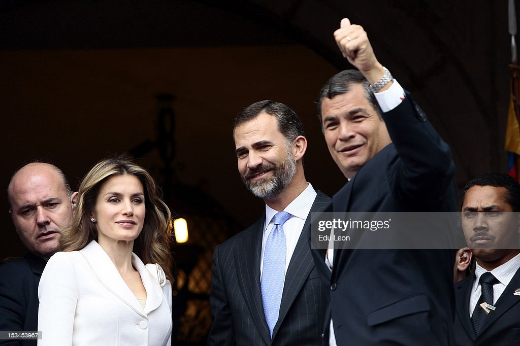 Princess Letizia Ortiz (L), Prince Felipe de Borbon (C) and Ecuadorean President <a gi-track='captionPersonalityLinkClicked' href=/galleries/search?phrase=Rafael+Correa&family=editorial&specificpeople=2294079 ng-click='$event.stopPropagation()'>Rafael Correa</a> (R) greet to the public from the Presidential Palace during an official on October 05, 2012 in Quito, Ecuador.