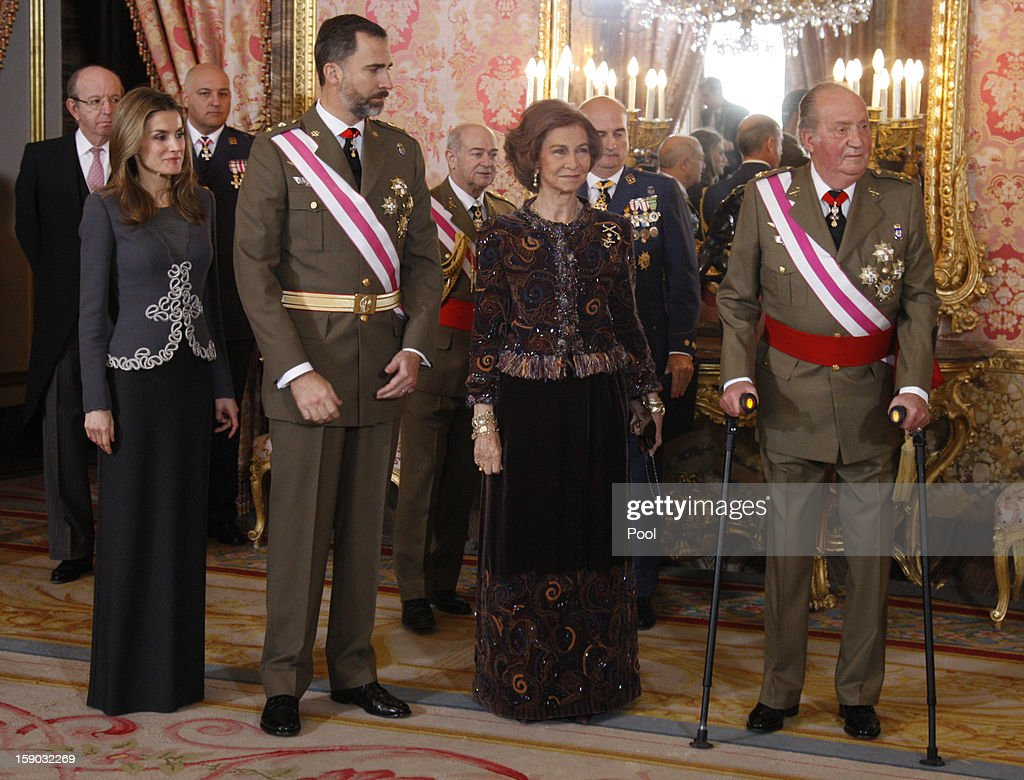 Princess Letizia Ortiz, Prince Felipe de Borbon, <a gi-track='captionPersonalityLinkClicked' href=/galleries/search?phrase=Queen+Sofia+of+Spain&family=editorial&specificpeople=160333 ng-click='$event.stopPropagation()'>Queen Sofia of Spain</a> and King <a gi-track='captionPersonalityLinkClicked' href=/galleries/search?phrase=Juan+Carlos+I&family=editorial&specificpeople=159452 ng-click='$event.stopPropagation()'>Juan Carlos I</a> attend the new year's military parade at the Royal Palace on January 6, 2013 in Madrid, Spain.