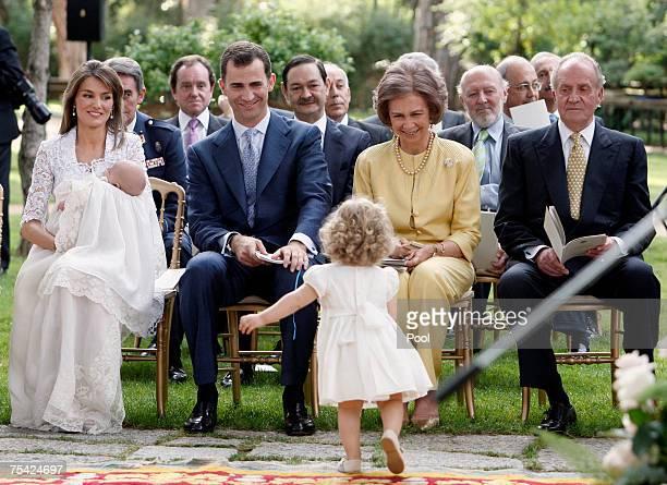 LR Princess Letizia Princess Sofia Crown Prince Felipe Princess Leonor Queen Sofia and King Juan Carlos of Spain sit during the baptism of Princess...