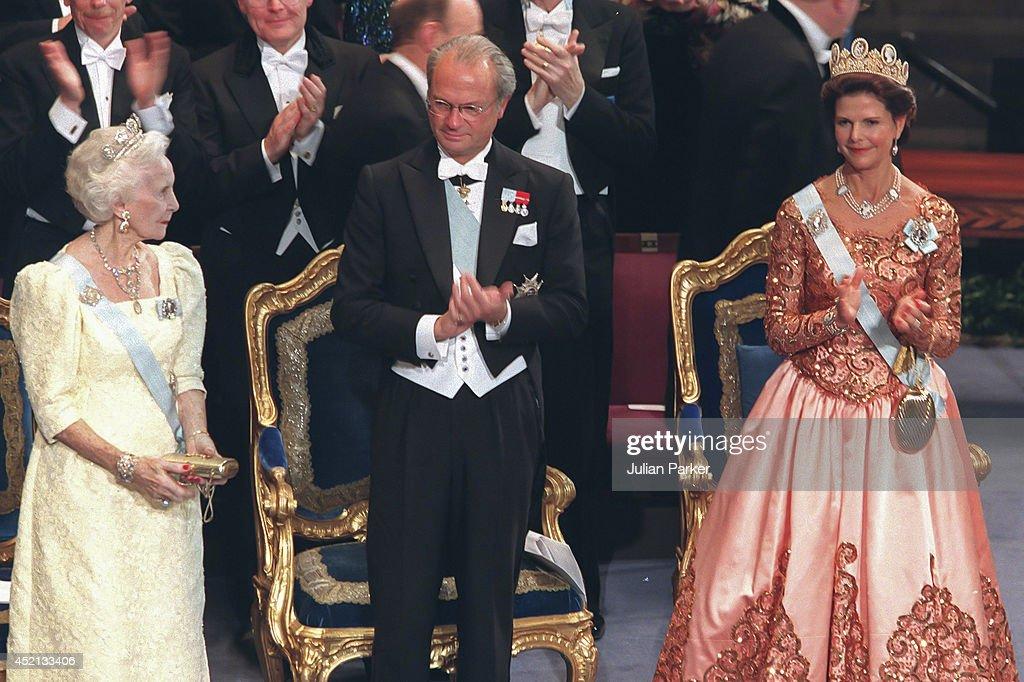 STOCKHOLM, SWEDEN - DECEMBER 10; Princess Lillian, King Carl Gustaf, and Queen Silvia of Sweden attend the Nobel Prize Ceremony at Stockholm Concert Hall, during the 1998 Nobel Festivities, on December 10 1998 in, Stockholm, Sweden.