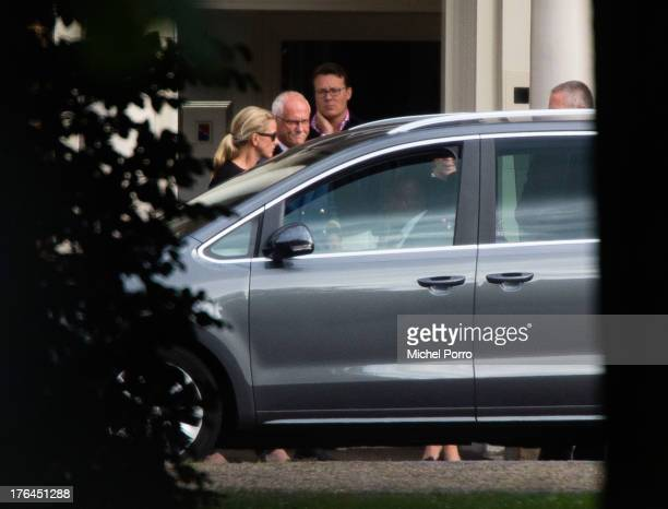 Princess Mabel of The Netherlands a member of the Palace staff and Prince Constantijn of The Netherlands leave the Huis ten Bosch Palace after...