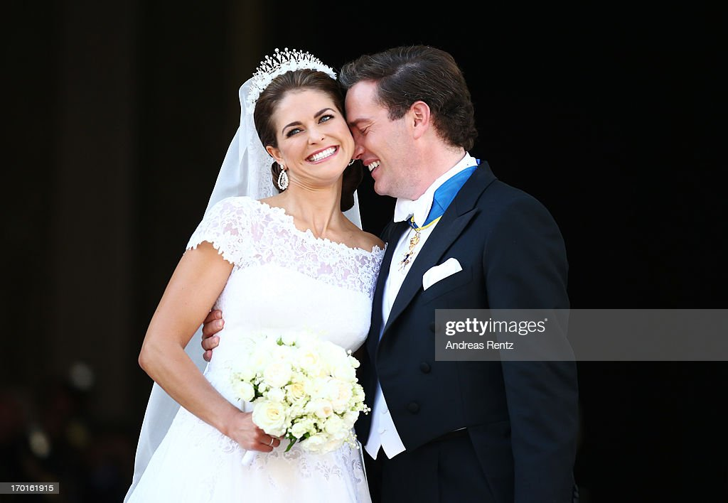 Princess Madeleine of Sweden and Christopher O'Neill appear on the balcony after the wedding of Princess Madeleine of Sweden and Christopher O'Neill hosted by King Carl Gustaf XIV and Queen Silvia at The Royal Palace on June 8, 2013 in Stockholm, Sweden.