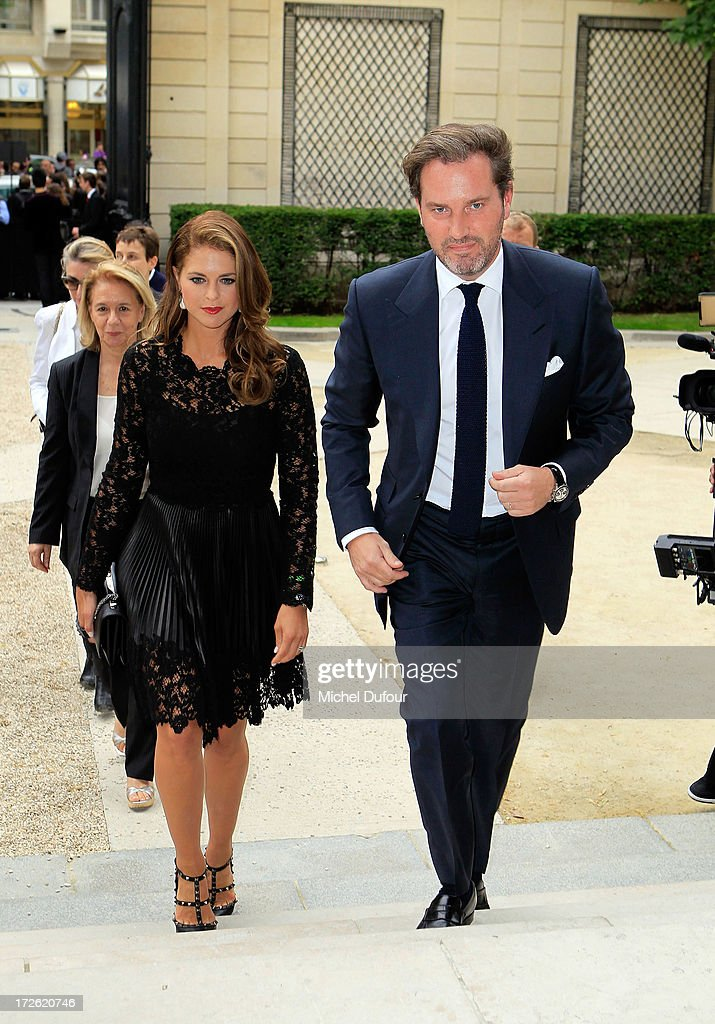 <a gi-track='captionPersonalityLinkClicked' href=/galleries/search?phrase=Princess+Madeleine+of+Sweden&family=editorial&specificpeople=160243 ng-click='$event.stopPropagation()'>Princess Madeleine of Sweden</a> and <a gi-track='captionPersonalityLinkClicked' href=/galleries/search?phrase=Christopher+O%27Neill+-+Husband+of+Princess+Madeleine&family=editorial&specificpeople=7470611 ng-click='$event.stopPropagation()'>Christopher O'Neill</a> attend the Valentino show as part of Paris Fashion Week Haute Couture Fall/Winter 2013-2014 at Hotel Salomon de Rothschild on July 3, 2013 in Paris, France.