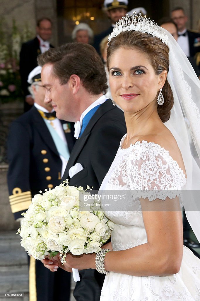 Princess Madeleine of Sweden and Christopher O'Neill depart from the wedding ceremony of Princess Madeleine of Sweden and Christopher O'Neill hosted by King Carl Gustaf XIV and Queen Silvia at The Royal Palace on June 8, 2013 in Stockholm, Sweden.